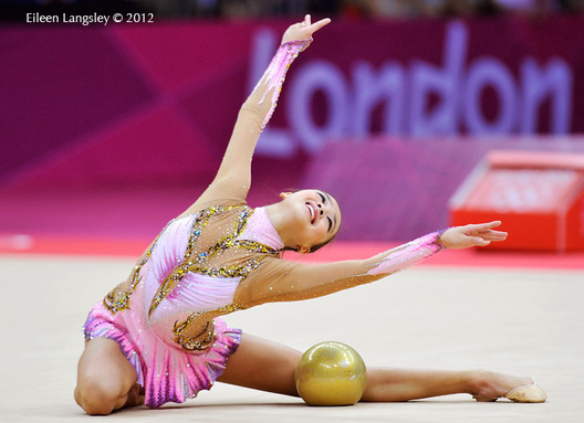 Yeon Jae Son (Korea) at the end of her routine with Ball during the Rhythmic Gymnastics competition at the 2012 London Olympic Games.