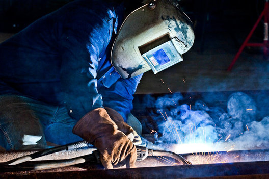 Israel Salinas welds pipe at Harris Fabrication in Mathis, Texas. 