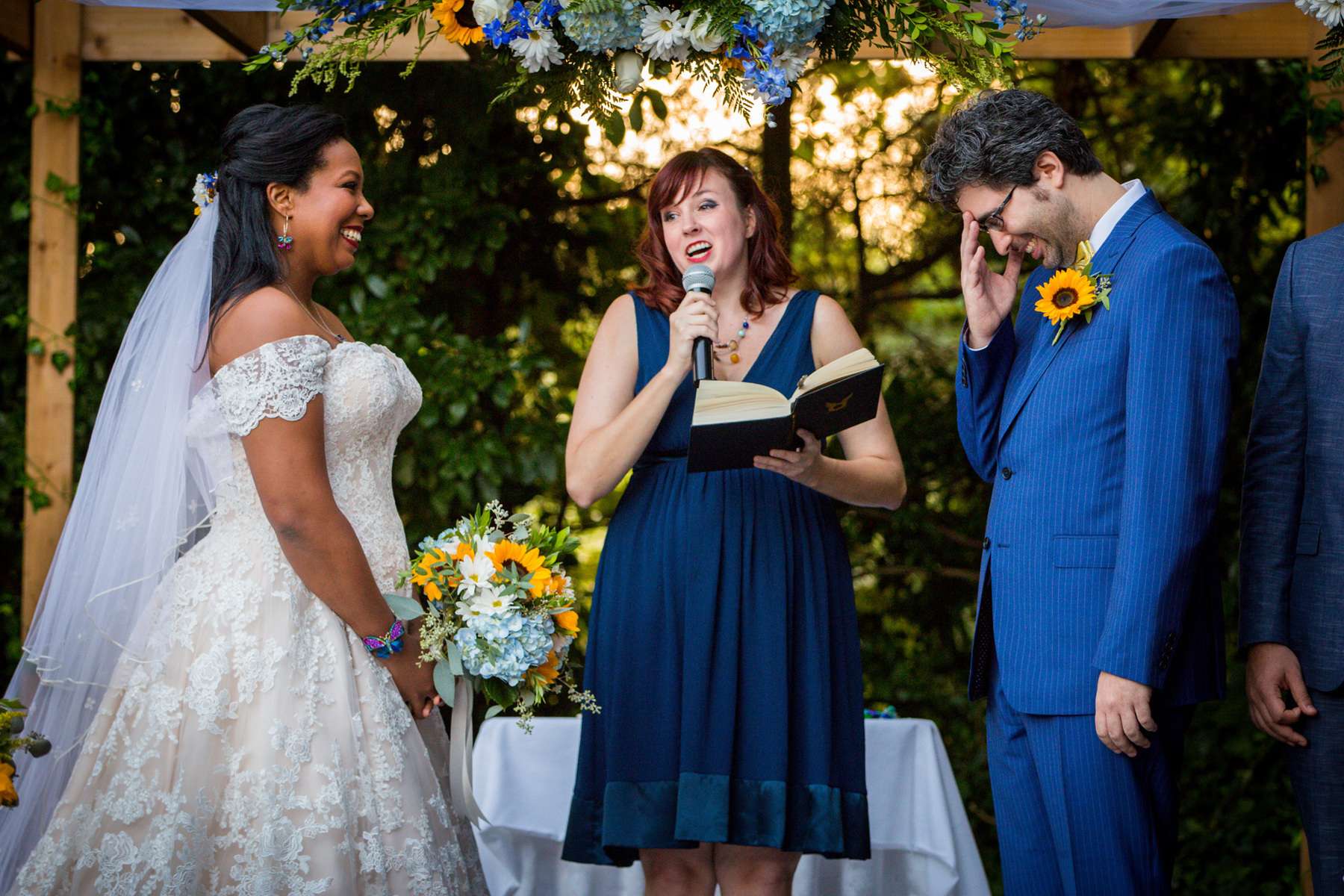 Long Island wedding photographer funny moment during vows with friend as officiant in mixed race wedding