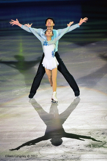 Cheng Peng and Hao Zhang competing in the Pairs competition at the 2012 ISU Grand Prix Trophy Eric Bompard at the Palais Omnisports Bercy