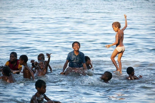 The children played on a 30 foot floating log off the shore of West New Britain Island in Papua New Guinea for hours.