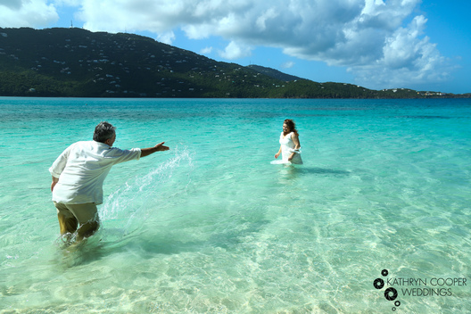 Bride and groom get in ocean in wedding clothes by Kathryn Cooper Weddings, Caribbean