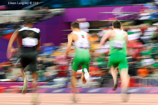 A blurred motion generic image of the Mens 100 metres T13 final with the winner Jason Smyth (ireland) on the right during the Athletics competition of the London 2102 Paralympic Games.