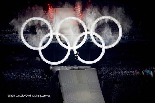 A spectacular moment as a skateboarder leaps through the Rings at the beginning of the Opening Ceremony of the 2010 Vancouver Winter Olympic Games.
