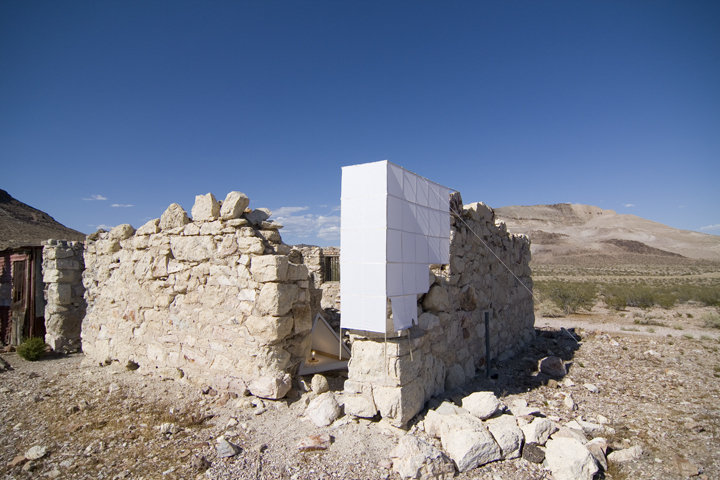A temporary work that re-built a piece of 1850s jail-cell from the gold-rush town of Goldwell, Nevada. It was a play on weight and scale - finishing the fortress of stone (destroyed by time) with paper and light.