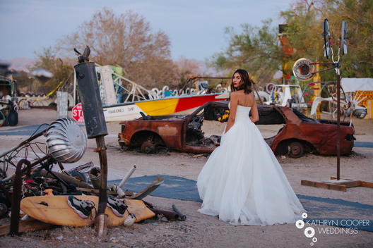 Unique wedding photo ideas - junkyard wedding in art park desert, Southern California