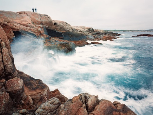 Two spectators watch the crashing waves during a storm at Peggy's Cove Nova Scotia