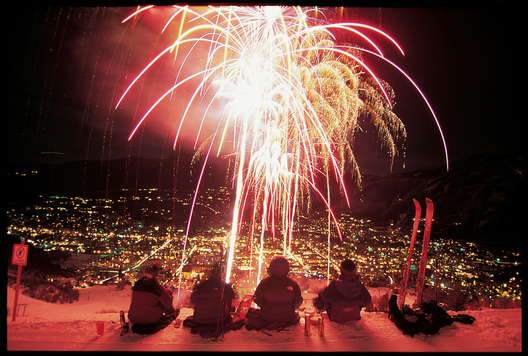 Skiers enjoy watching Winterskol fireworks from Aspen Mountain.  Michael Brands.