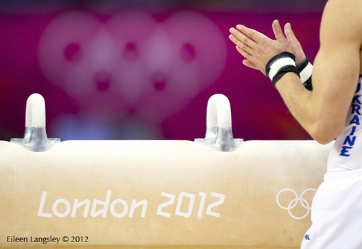 A cropped generic image of the hands of a gymnast ready to compete on Pommel Horse at the London 2012 Olympic Games.