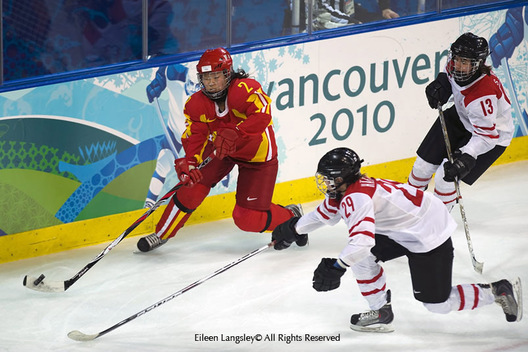 China's Yu Baiwei finds herself under pressure from Melamie Hafliger (29) and Sara Benz (13) of Switzerland in their match at the 2010 Winter Olympic Games in Vancouver.
