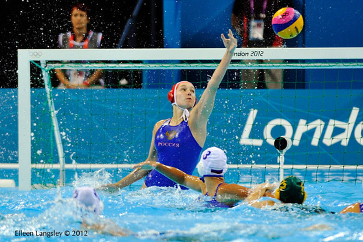 The Russian goalkeeper Maria Kovtunovskaia saves a shot at goal during their Water Polo match against Australia.