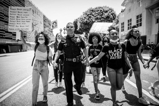 Santa Monica Police Sergeant Leyva marches with Santa Monica High School students as they protest Police brutality, Santa Monica, California June 4 2020. The protests against police brutality were sparked by the death of George Floyd while in police custody in Minneapolis.