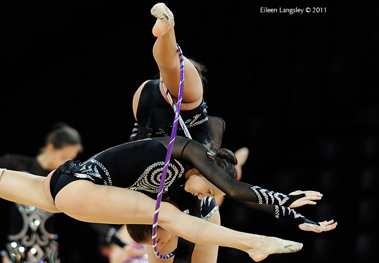 A cropped action image of the group from Bulgaria training a difficult and original move at the World Rhythmic Gymnastics Championships in Montpellier.