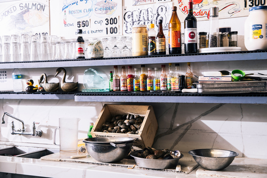 The counter lined with condiments and a box of live clams is pictured at Swan Oyster Depot in San Francisco, Calif. on Tuesday, April 2, 2019.