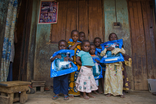 Children in Abuja, Nigeria hold Permanet long-lasting insecticide treated mosquito nets.  Permanet is manufactured by Vestergaard-Frandsen and distributed in Nigeria by the Society for Family Health (SFH), Nigeria's largest indigenous NGO.