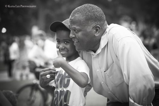"Mayor Steve Benjamin poses with young child at ""Columbia Stands with Charlottesville.""  After the events in Charlottesville in which Heather Heyer was murdered after a ""Unite the Right"" rally, more than 200 people gathered in solidarity  at the State House grounds.   August 14, 2017"