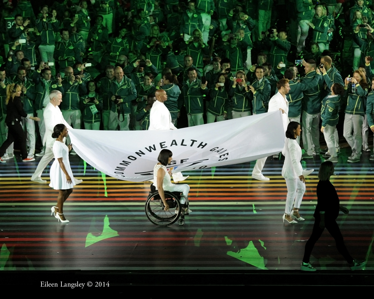 The flag of the Commonwealth Games federation is carried into the arena during the Opening Ceremony at the 2014 Glasgow Commonwealth Games .