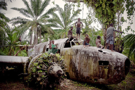 An abondoned WWII bomber in the jungles of West New Britain Island in Papua New Guinea acts as a great playground.