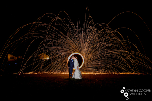 Fire spinning wedding photo - steel wool wedding photography of lesbian couple in Maine