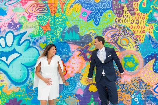 NYC elopement photographer for nyc stylish wedding in front of graffiti in Brooklyn