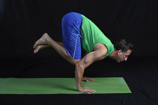 Arm balance, strengthens the wrists, forarms & abdomen while improving balance.