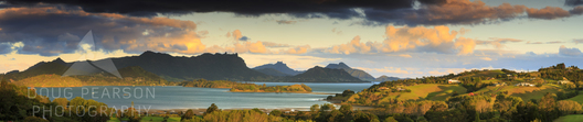 Dramatic warm light illuminates the dream-like landscapes of Parua Bay and the Whangarei Heads.