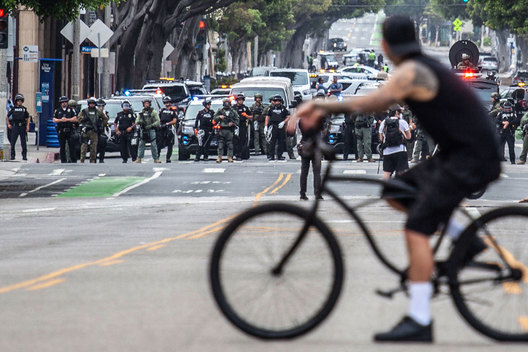 Peaceful Demonstrators angered over the death of George Floyd at the hands of police in Minneapolis face off against Police officers in riot gear and SWAT teams on the border of Venice and Santa Monica at the corner of Main Street and Rose Avenue.