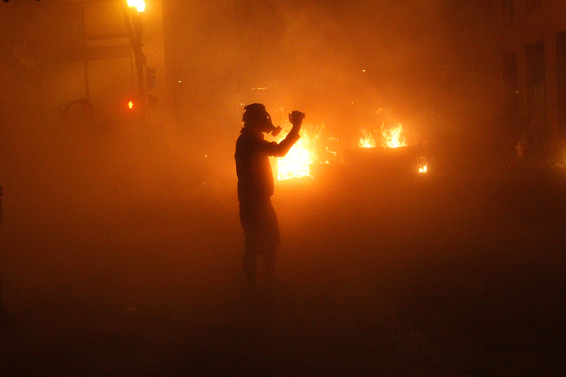 A demonstrator uses a video camera as he stands in a cloud of tear gas shot by police at the Occupy Oakland demonstration in Oakland, California, November 3, 2011. Police in riot gear clashed with protesters in Oakland in the early morning hours on Thursday, firing tear gas to disperse demonstrators lingering in the streets after a day of mostly peaceful rallies against economic inequality and police brutality.