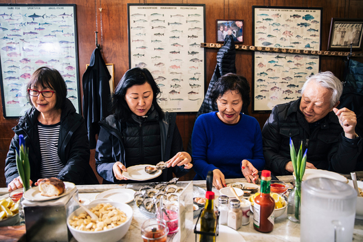 (L-R) Kay Kim, Angela Kim, Chung Kang, and Kyung Kang enjoy a meal at Swan Oyster Depot in San Francisco, Calif. on Tuesday, April 2, 2019.