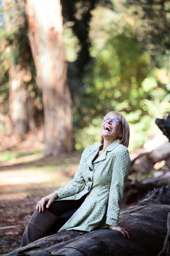 Editorial portrait of woman laughing at the park by commercial photographer Nancy Rothstein