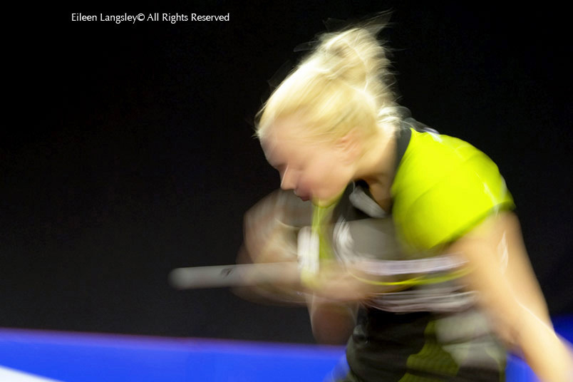 A blurred action image of a Krisztina Toth (Hungary) in action at the 2009 English Open Table Tennis Championships at the English Institute of Sport Shefield.