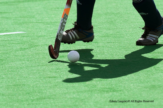 A cropped generic action image of a player showing ball control during the England Versus Netherlands match at the 2010 Women's World Cup Hockey Tournament in Nottingham