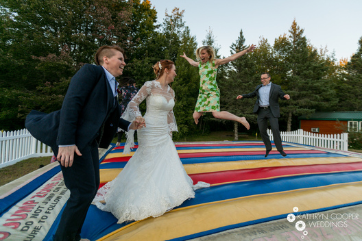 Bouncy house wedding with fun same sex wedding and jumping in Maine #lovewins