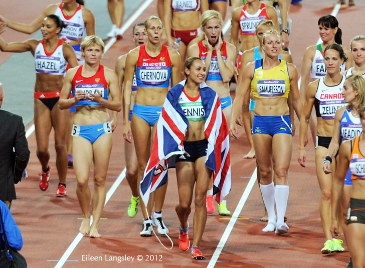 Surrounded by fellow heptathletes, Jessica Ennis (Great Britain) celebrates winning the gold medal at the 2012 London Olympic Games.