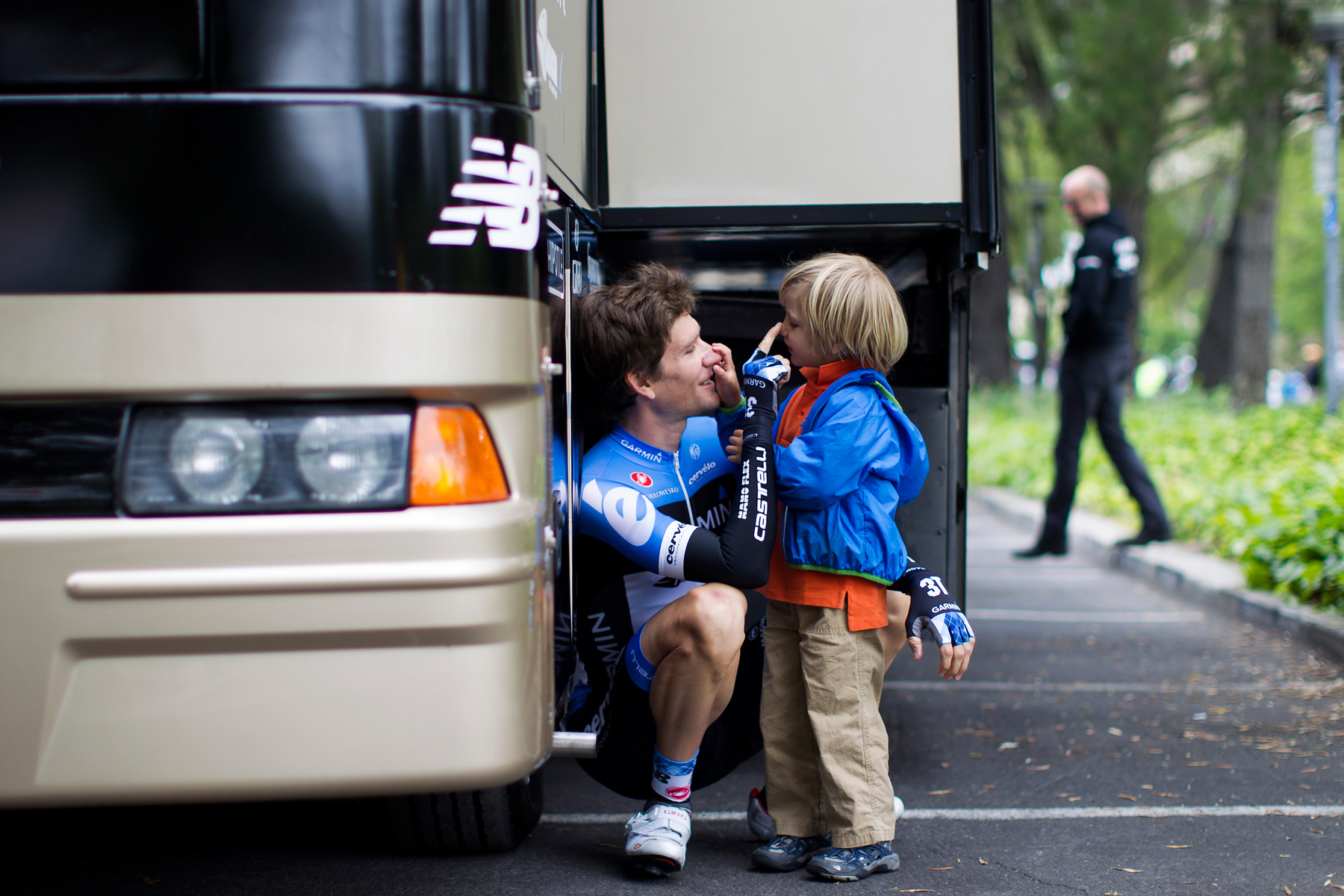 Team Garmin-Barracuda's Dave Zabriskie shares a moment with his son behind the team bus prior to stage one of the Amgen Tour of California in Santa Rosa, Calif. on Sunday, May 13, 2012.