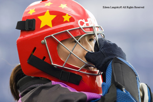 A cropped action portrait ofChina's goalkeeper Ma Yibo putting on her helmet before their match against Argentina at the 2010 Women's World Cup Hockey Tournament in Nottingham.