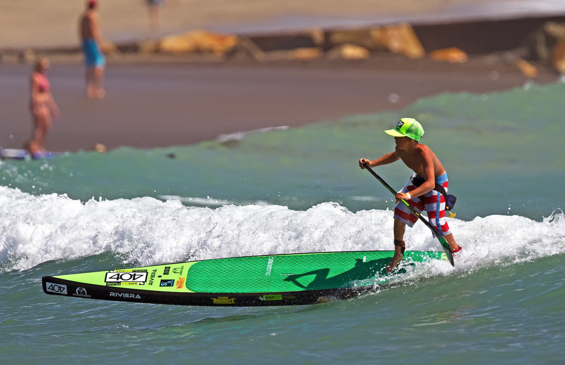 Dana Point, CA - September 30: A paddle boarder catches a wave following the Battle of the Paddle, on September 30, 2012 at Doheny Beach in Dana Point, California.