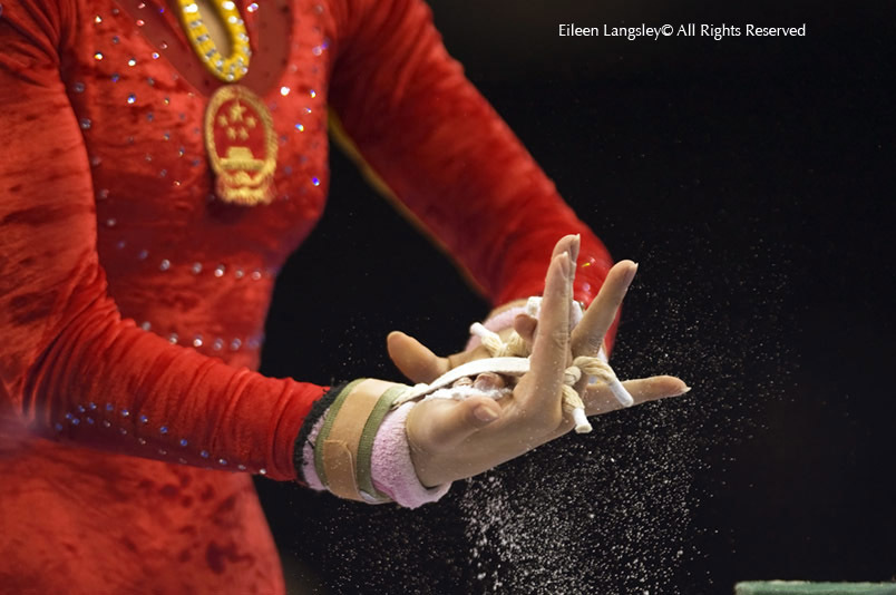 A generic images of the hands of a Chinese gymnasts as she chalks up before competing on the asymmetric bars.