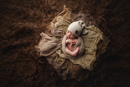 Studio 708 specializes in Newborn Photography.  Oshkosh's Premier Portrait Studio
