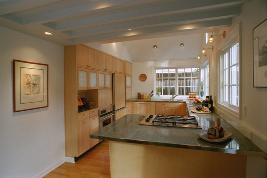 A subtractive rather than additive approach is employed for the major interior remodel of a modestly sized, two-story residence. 