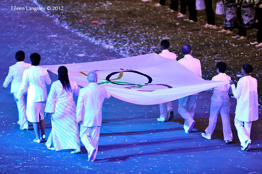 The Olympic Flag is carried in to the stadium during the Opening Ceremony at the London 2012 Olympic Games.