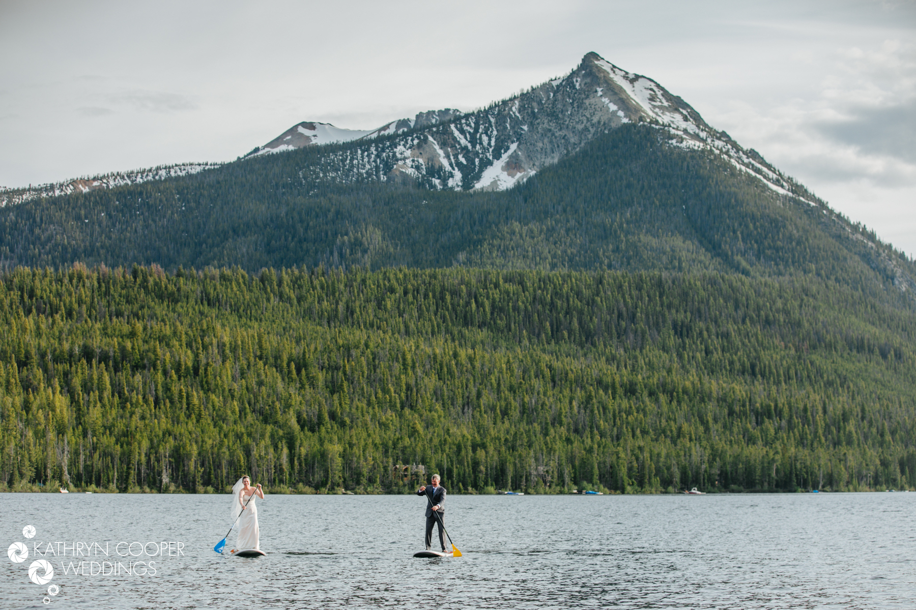 SUP couple on lake in Idaho - Petit Lake adventure photographer