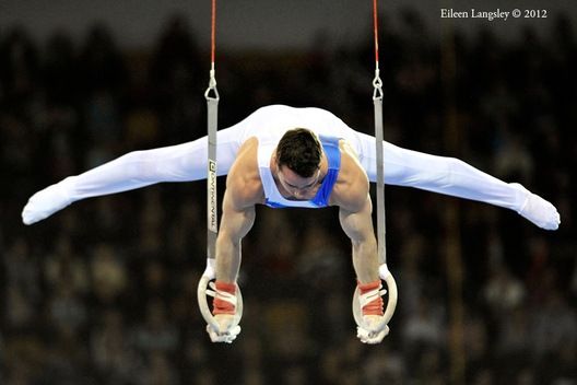 Kristian Thomas (Great Britain) competing on Rings at the 2012 FIG World Cup in the Emirates Arena