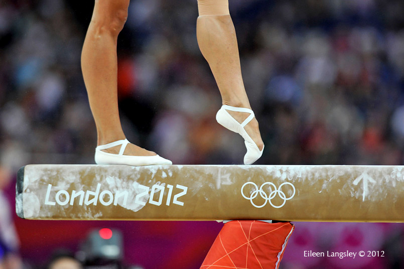 A generic image of the feet of a female gymnast on the Balance b
