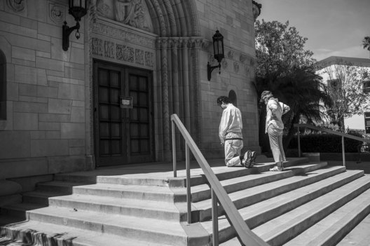 Strange Days; Life under Covid 19. As churches everywhere were closed, devout parishioners were forced to say their prayers on the steps of St. Monica's Catholic Church, Santa Monica.