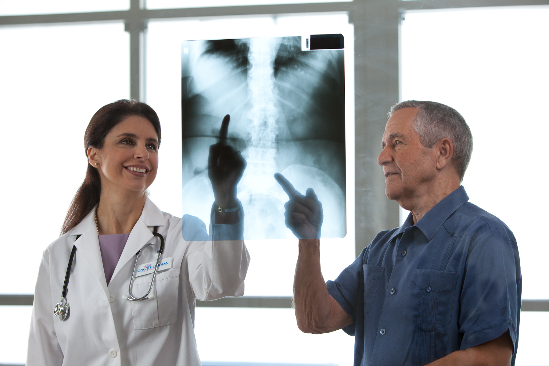 doctor & patient looking at x-ray