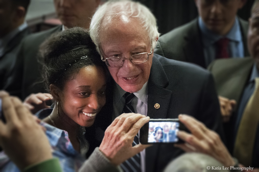Young woman poses for a photo with Bernie Sanders; Claflin University in Orangeburg SC on the HBCU (Historically Black Colleges and Universities) Tour February 2016