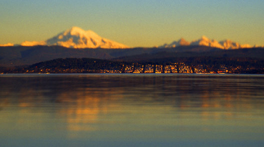 I used some tilt for this shot so that only the cute and wonderful little borough of fairhaven would be in focus.  across bellingham bay, the shore drive on the lummi indian reservation is a great drive because of the view of mount baker and the sisters range.