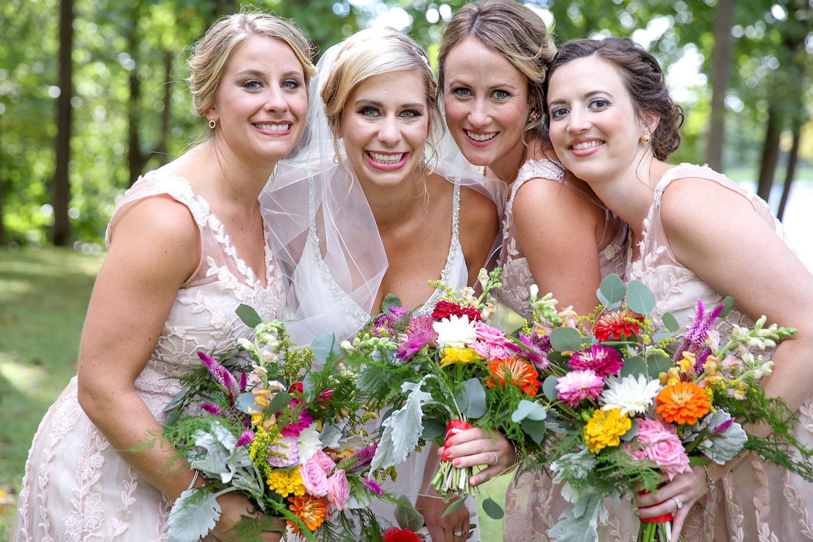 Audubon Park ky bridesmaids with flowers