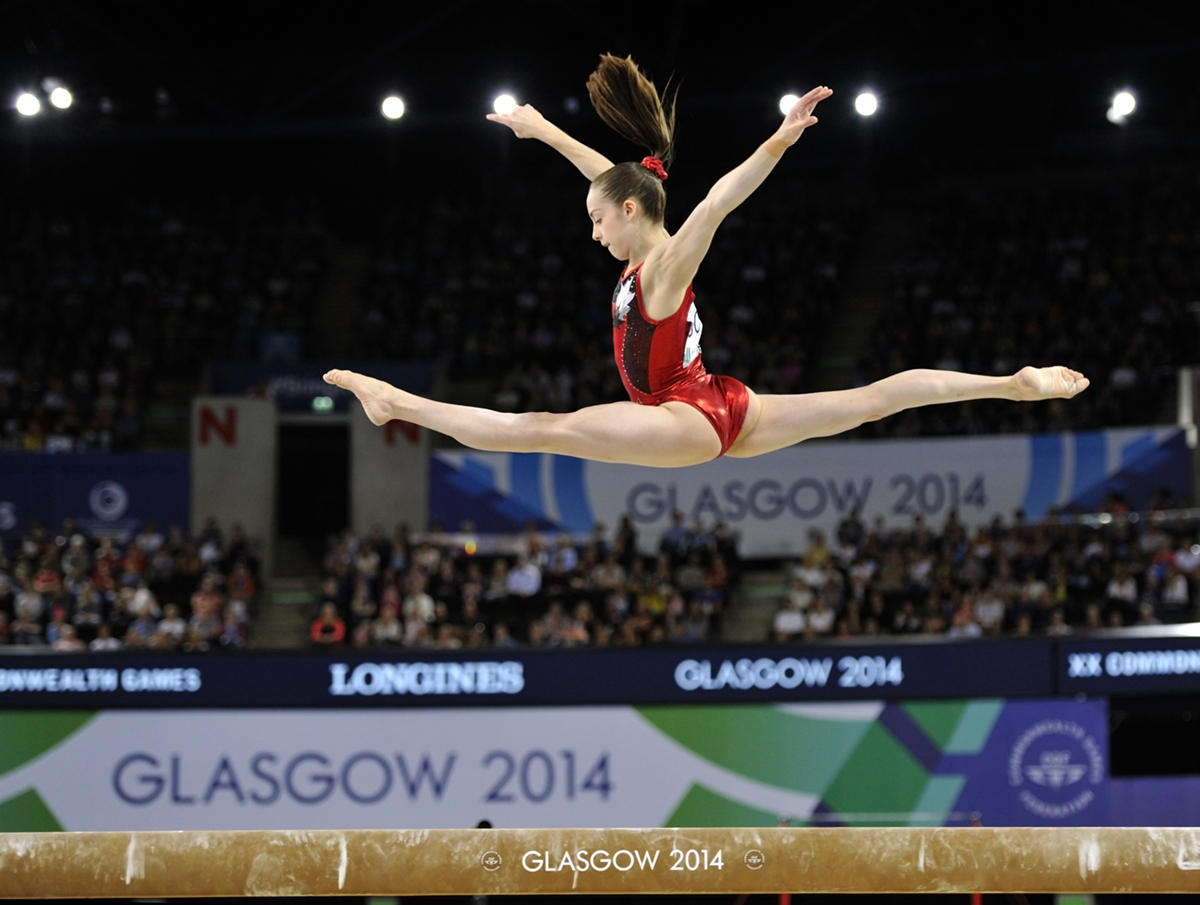 Isabela Onyshko (Canada) competing on Balance Beam at the 2014 Glasgow Commonwealth Games.
